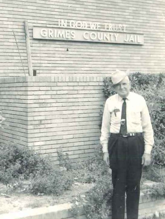 Sheriff Johnson stands outside the Grimes County Jail in the 1960s.